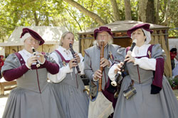woodwind players in renaissance costumes